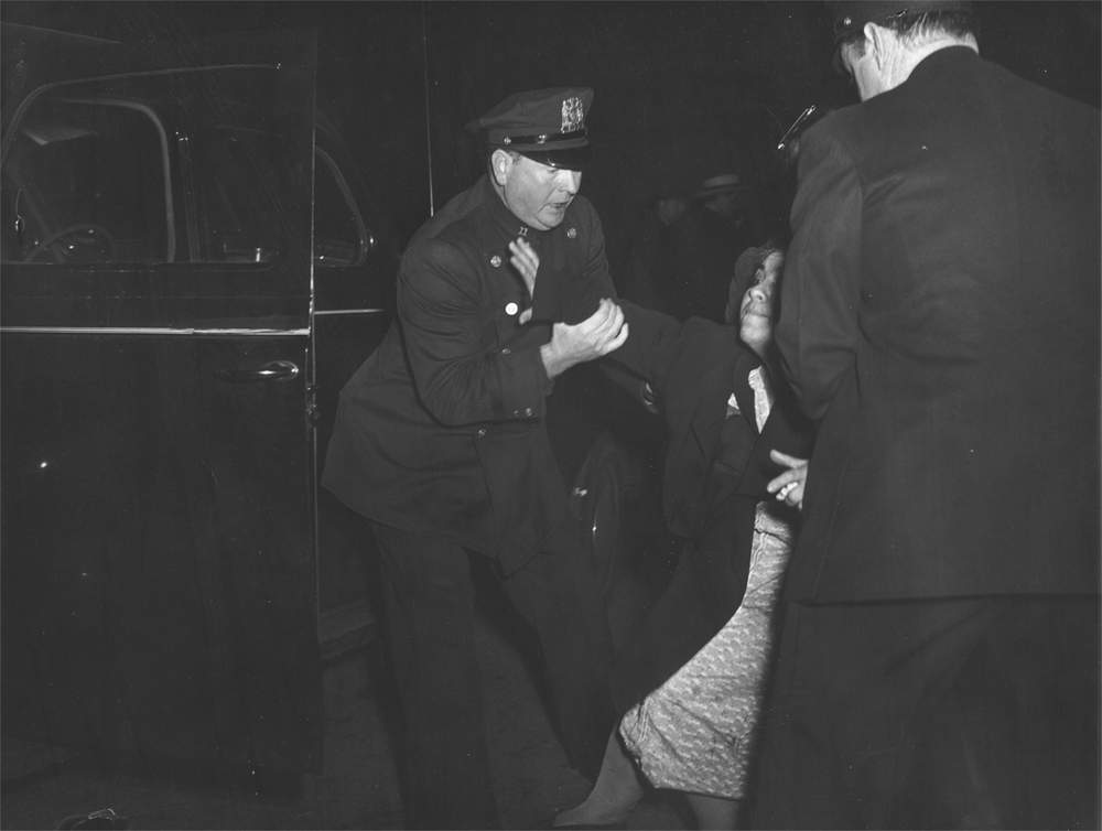 'The dead man's wife arrived...and then she collapsed', New York, 1941, Weegee