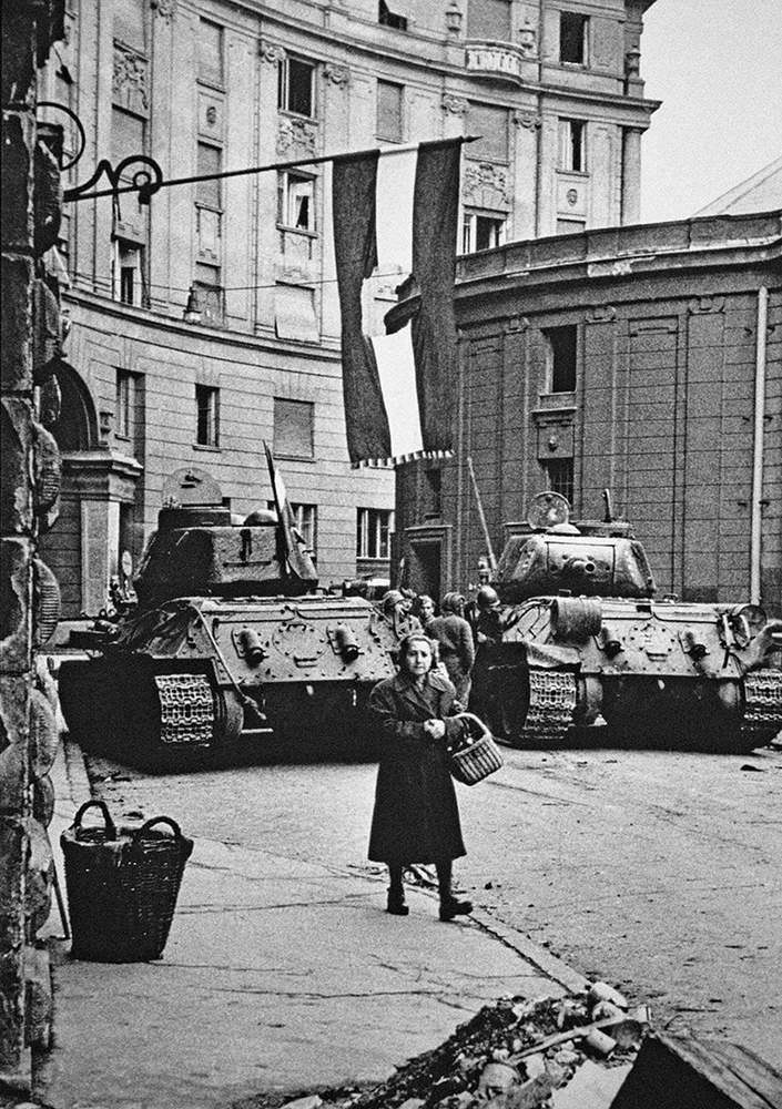 Woman shopping during a lull in fighting, Budapest, 1956