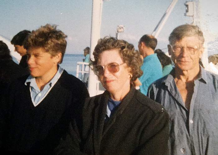 Tom and his parents on a ferry to France in the 1980s