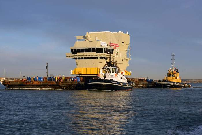 2013: The forward island of the Queen Elizabeth is transported out of Portsmouth Harbour