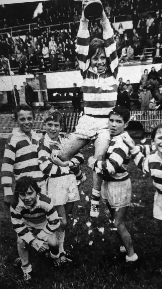 Schoolboys Cup victory at Cardiff Arms Park: Winning try scorer John Actie holds the captain aloft, with David Bishop crouching down (bottom left)