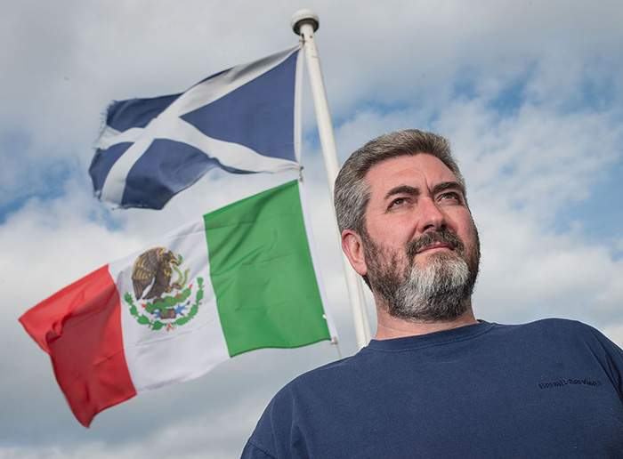 The Mexican flag flies from David Milne's home