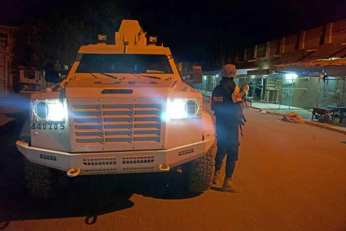 UN peacekeepers escort police by night