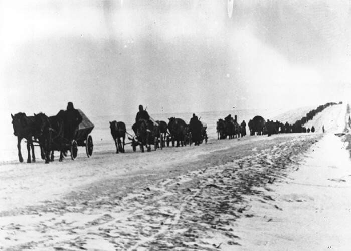 Germans soldiers retreating to the west by horse and cart on a snowy Soviet road in 1944