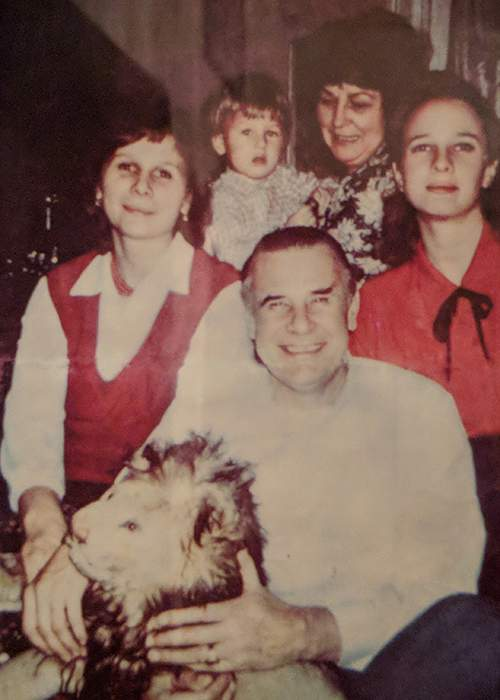 Yashin with his family (along with the stuffed lion toy)