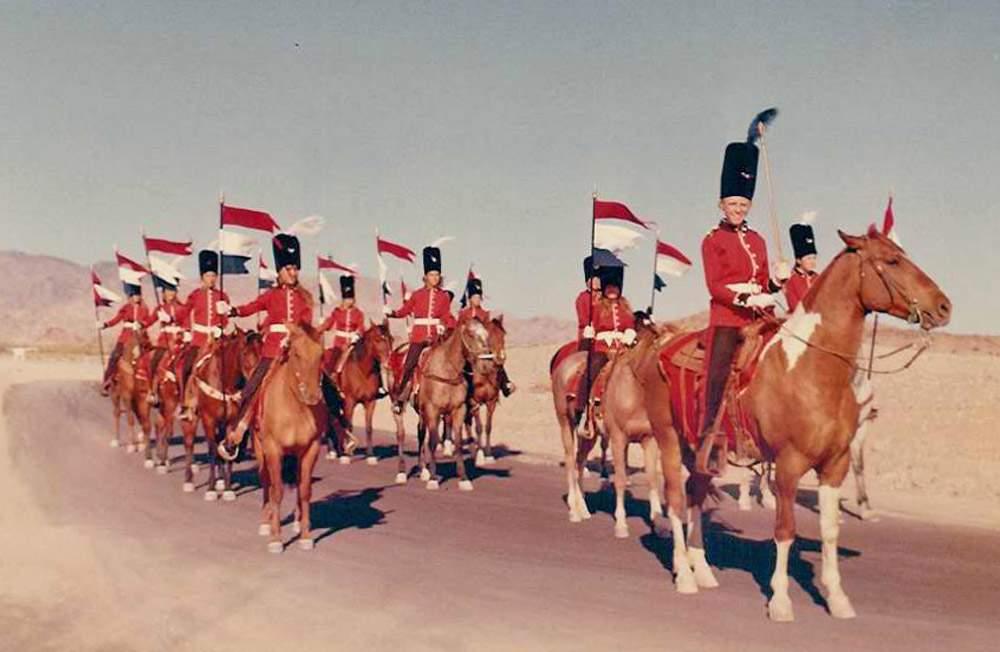 Riders on horseback made a strange sight against the desert backdrop