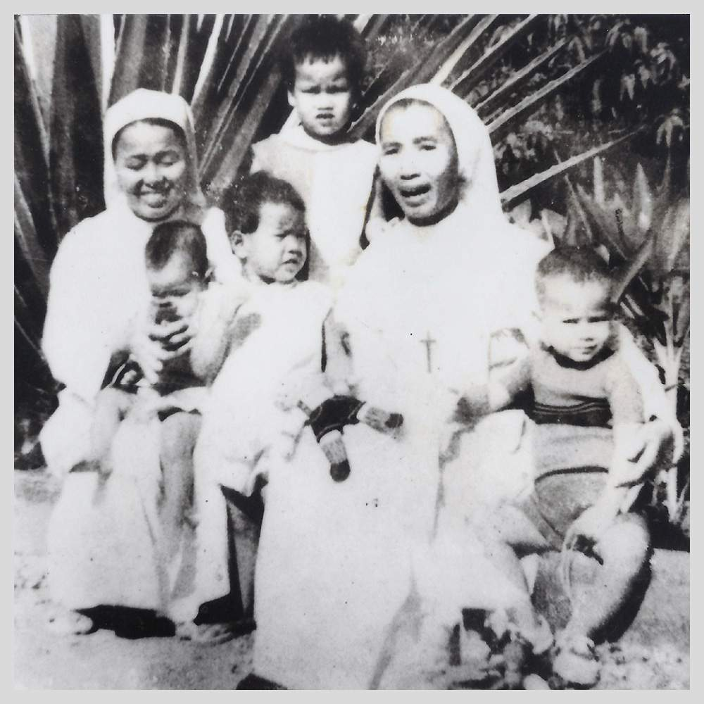 Tuy (r) with the nuns before he developed polio