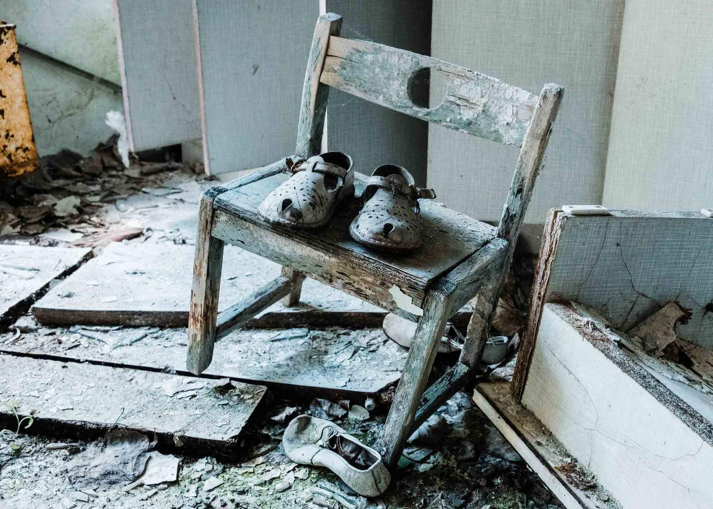 A child's shoes left behind in an abandoned nursery in the city of Pripyat