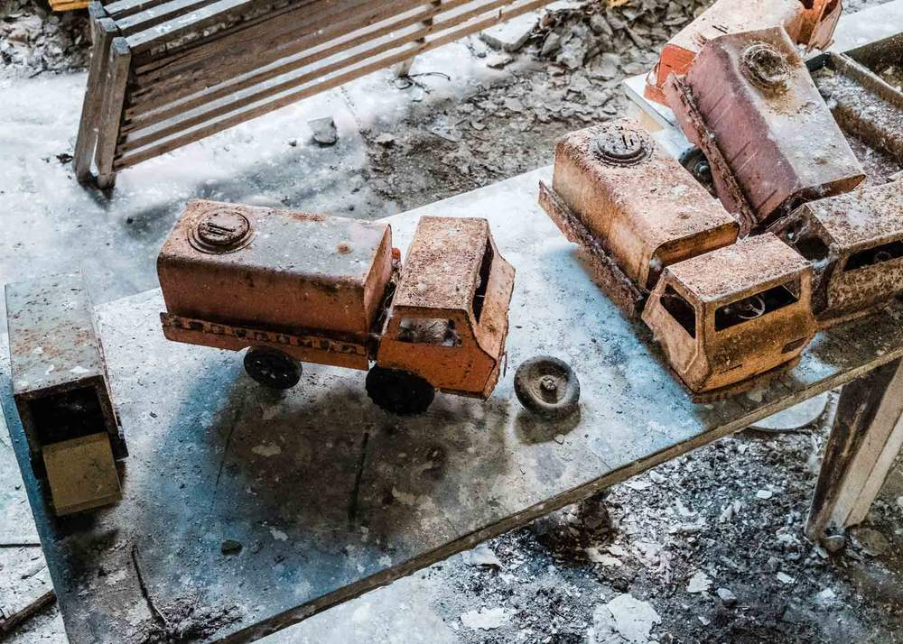 Toy trucks left behind in an abandoned nursery