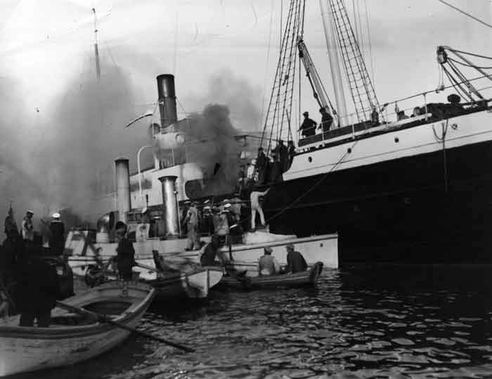 1915: A ship on fire in Salonica harbour