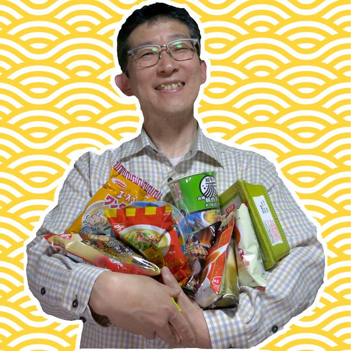 Toshio Yamamoto holding a few examples from his noodle collection