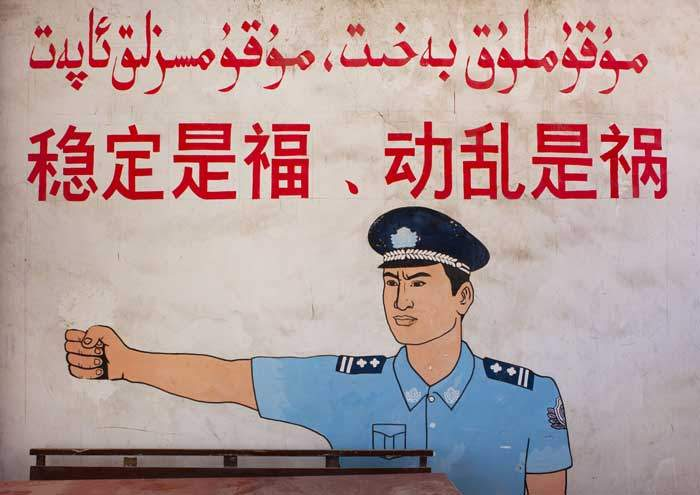 "A wall poster in Xinjiang reads: ""Stability is a blessing, instability is a calamity"""