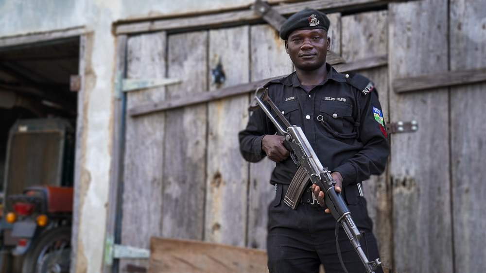 Policeman guarding the police headquarters in Jos