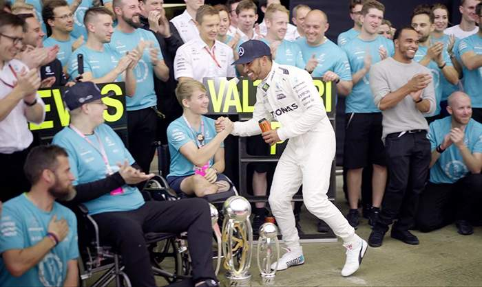 Billy celebrating with Lewis Hamilton at Silverstone