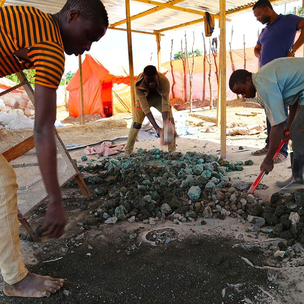 Artisanal miners sorting minerals