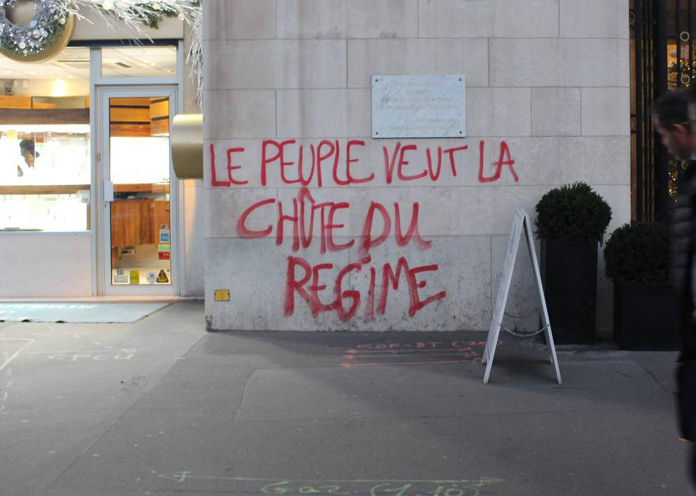 "Graffiti reads: ""The people want the fall of the regime"""