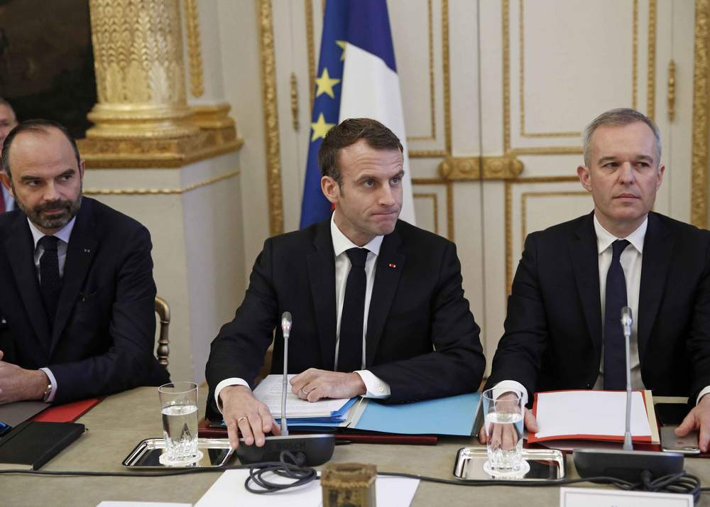 (From L) French Prime Minister Edouard Philippe, French President Emmanuel Macron and French Ecology Minister Francois de Rugy meet with representatives of trade unions