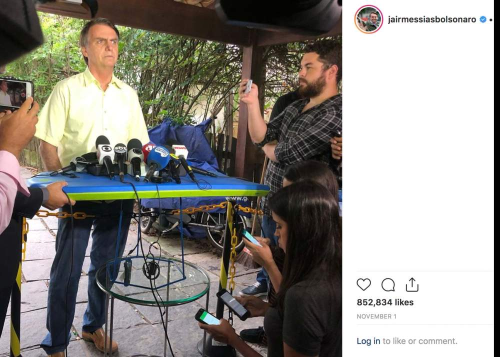 Microphones placed on top of a bodyboard at a press conference held at Bolsonaro's home