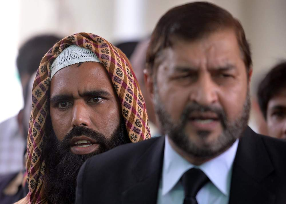 Qari Salim (L) and his lawyer Ghulam Mustafa Chaudhry (R) speak to the media outside the Supreme Court in Islamabad