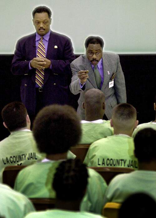 Carter and Reverend Jesse Jackson speak to inmates inside the Pitchess Detention Center in Los Angeles County, California