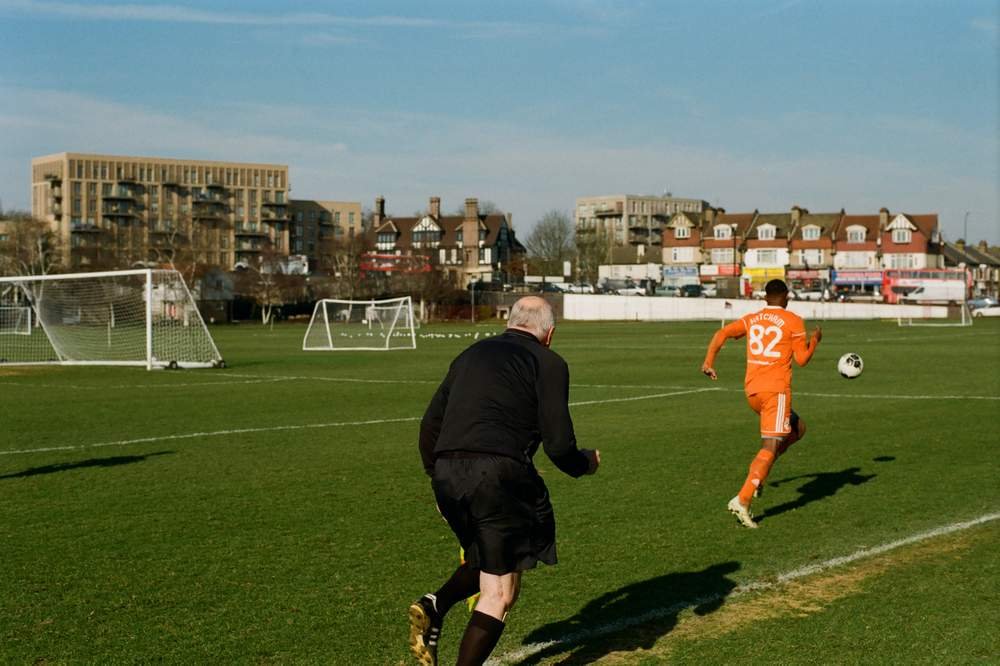 One linesman struggles to keep up with the action