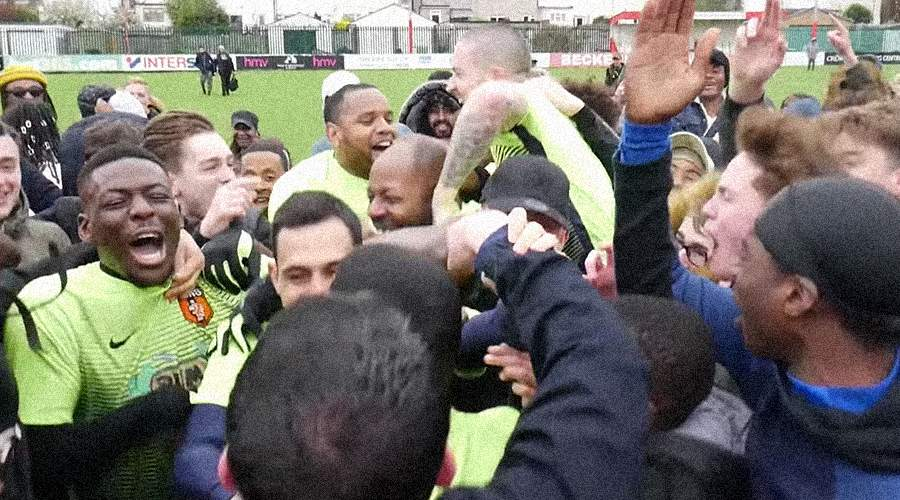 99b5c54ef7b SE Dons' players are mobbed by fans following their 2018 cup final win