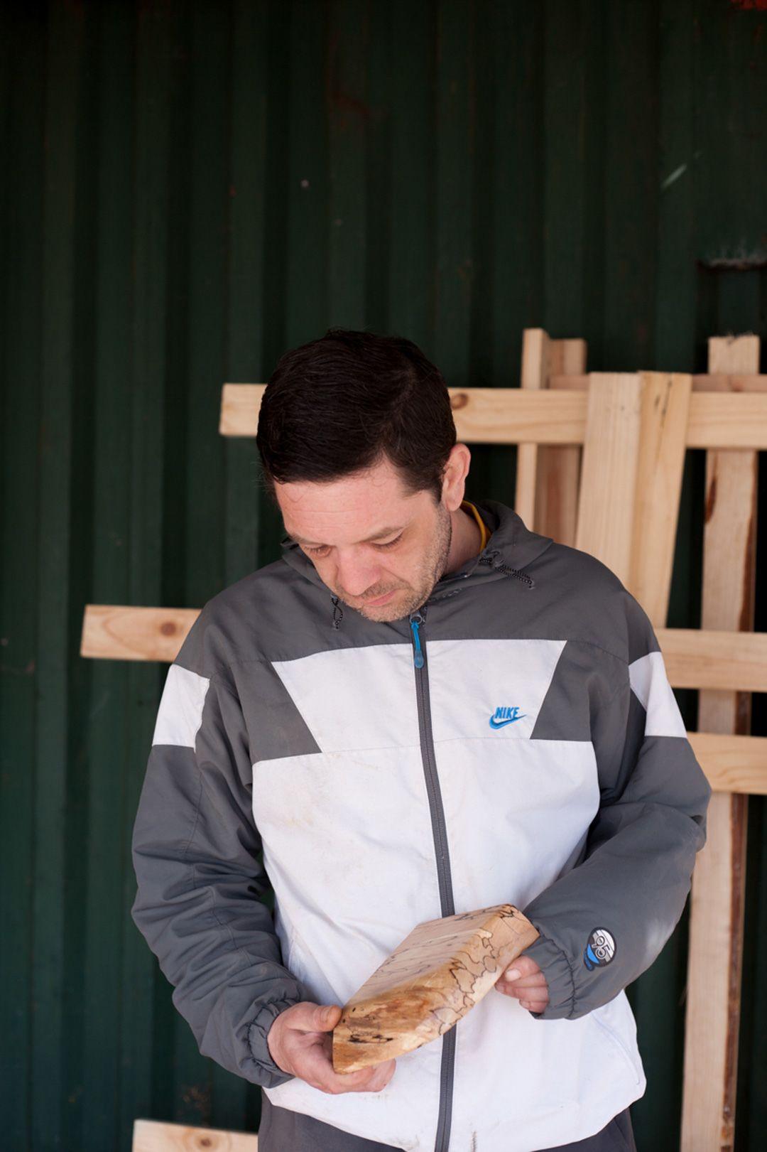 Joe Coughlan holding a piece of wood