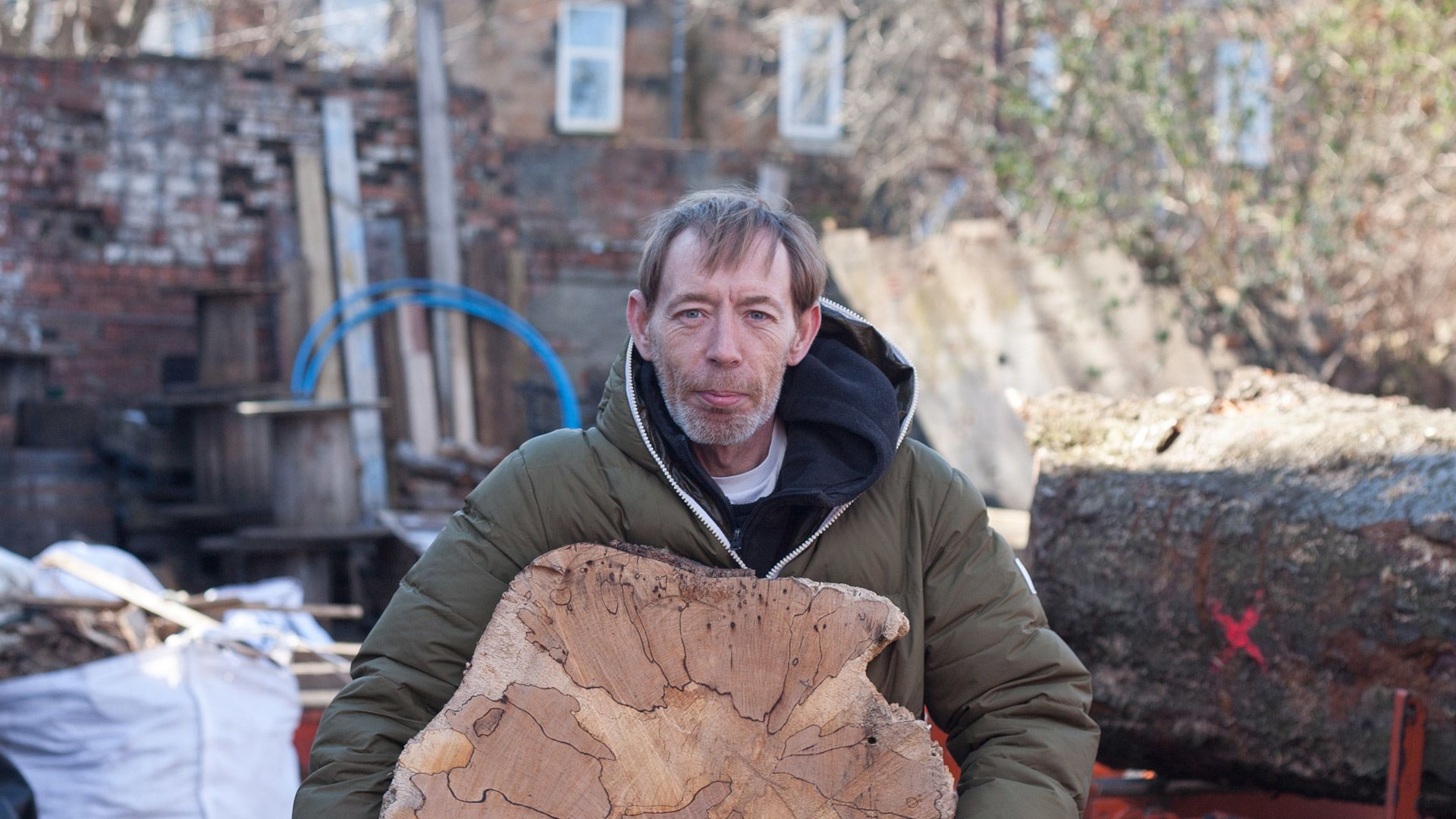 Man holding a piece of wood
