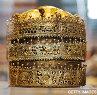 A Crown, made in Ethiopia around 1740, made of gold and gilded copper with glass beads, pigment and fabric is pictured at an exhibition, 'Maqdala 1868, A reflection on the 1868 siege and battle at Maqdala', at the Victoria and Albert museum in central London, on April 5, 2018