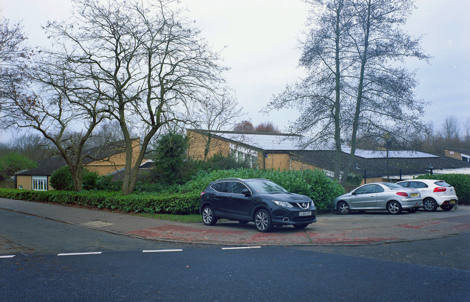 Today, this same building is Southwood Primary School. The trees have grown to obscure the buildings, but their distinctive roofs and the arc of the road are still clearly visible