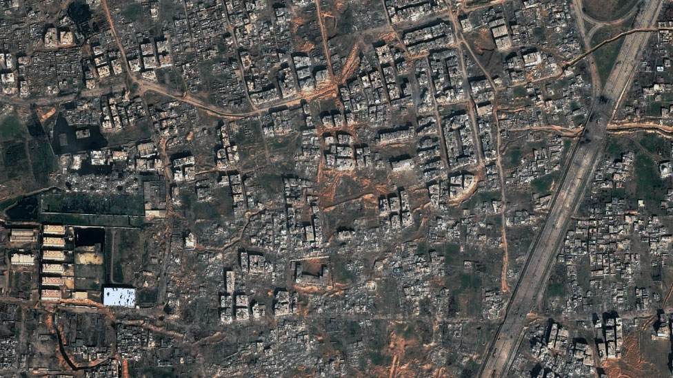 Satellite image shows many buildings have been destroyed in the residential neighbourhood of Jowbar
