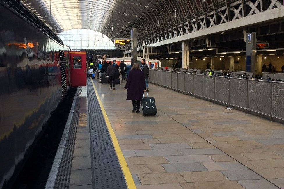People board train at Paddington Station in 2016