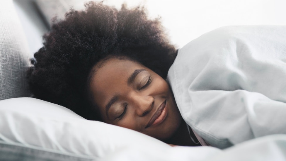 A woman in bed dreaming